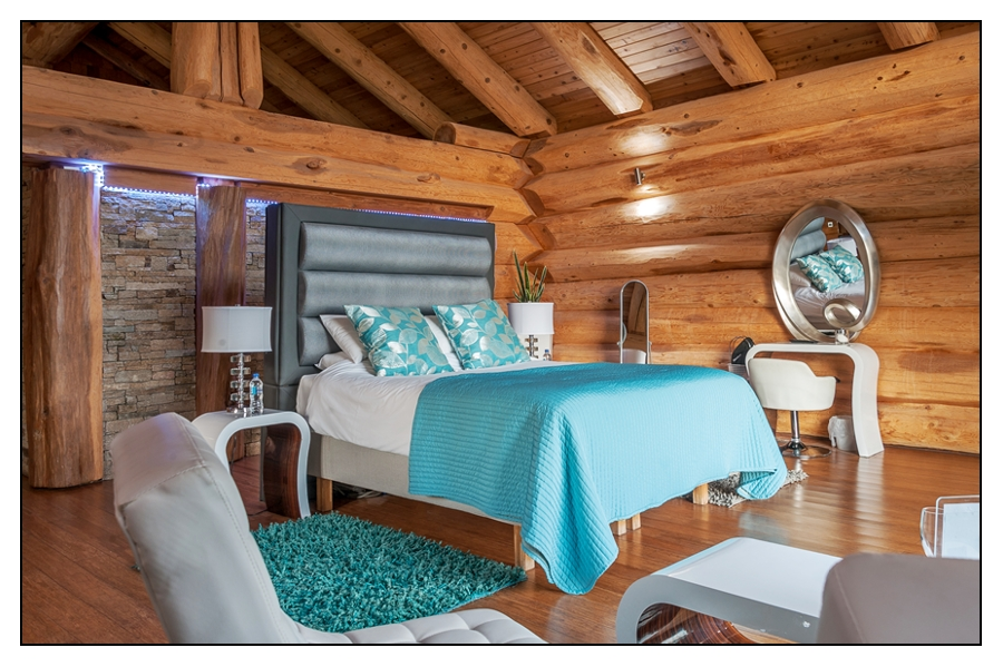 The bedroom in of the Canadian Log Cabins at The Vu
